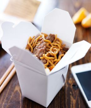 Container of Food Near Smartphone